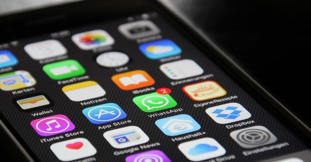 Closeup of an iPhone home screen, displaying a variety of apps