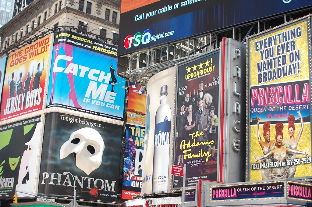 A 2011 shot of Times Square's Broadway promotional posters, including Jersey Boys, Wicked, Catch Me if You Can, Phantom of the Opera, The Addams Family, and Priscilla: Queen of the Dessert