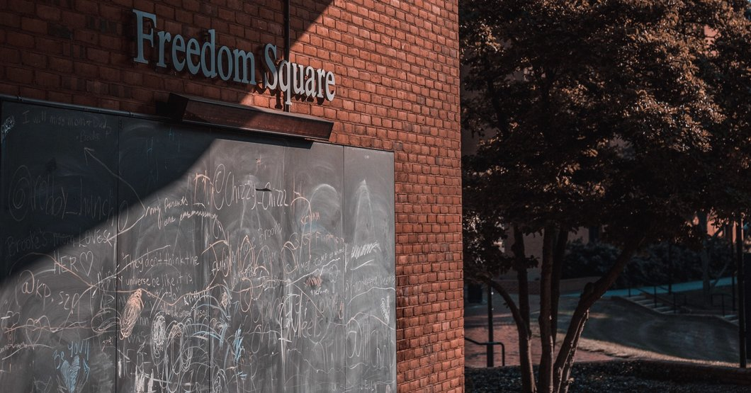 One of the chalkboards in Towson University's Freedom Square, under the location's name sign. Photo by MD photographer David Kirchner