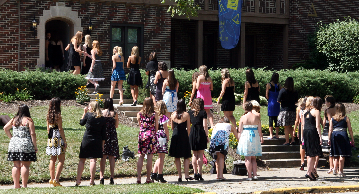 A group of girls lined up to enter a sorority house