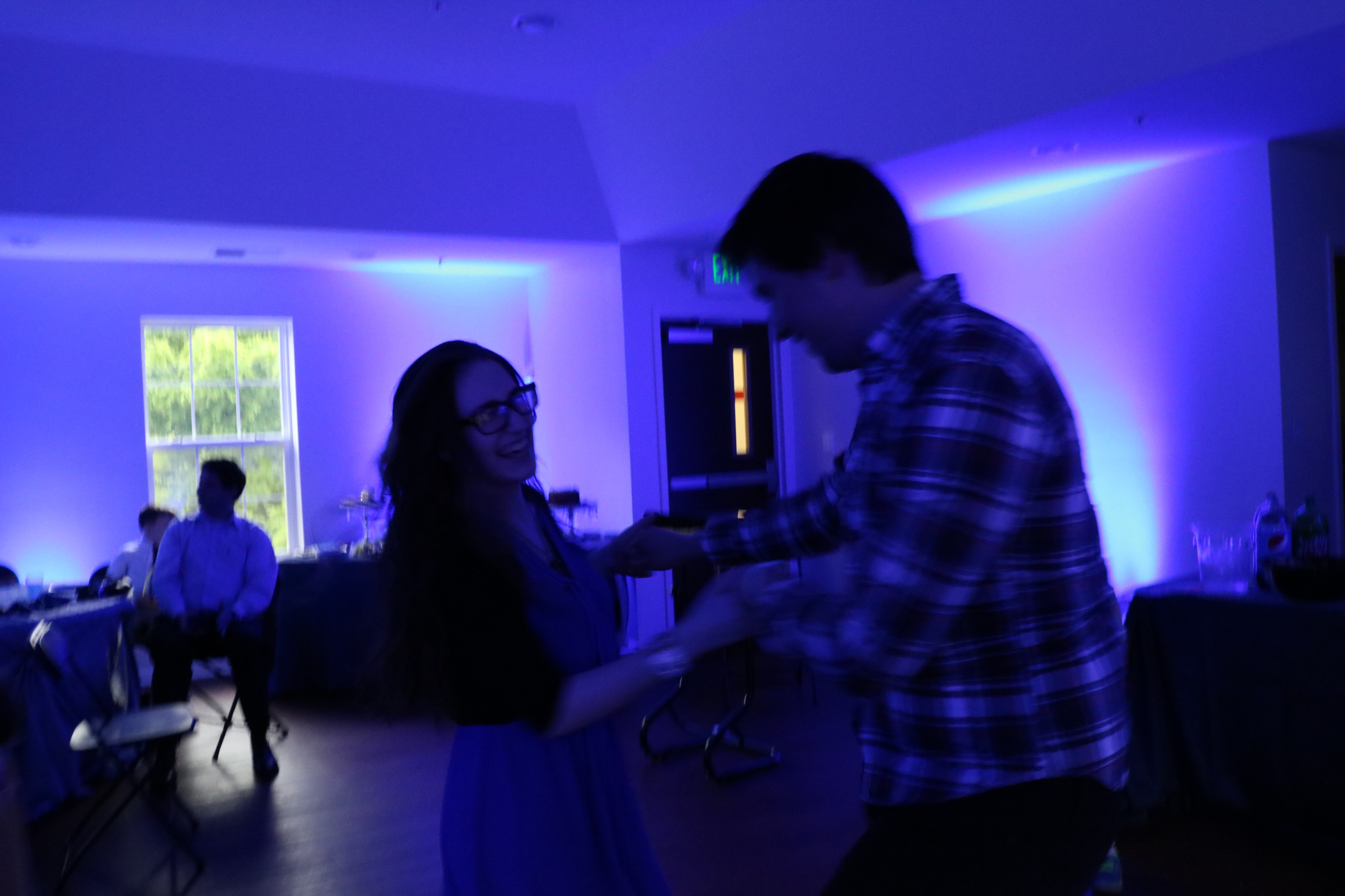 me and my boyfriend dancing and laughing in a blue-lit room