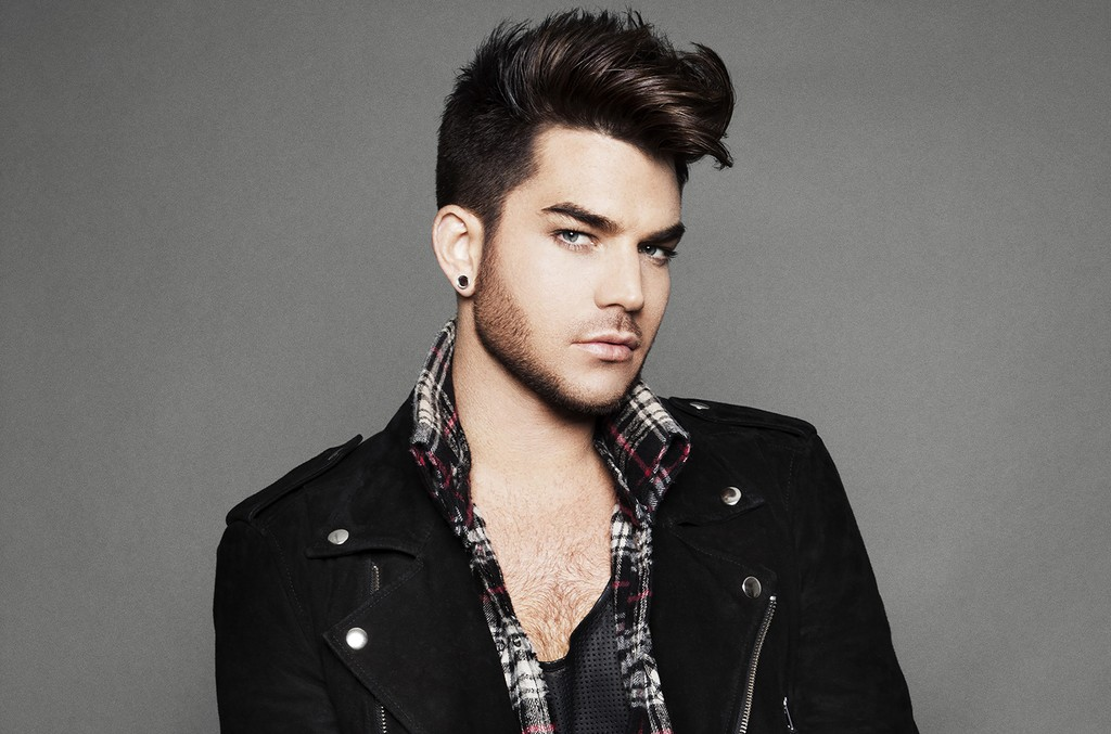 Adam Lambert in a leather jacket thrown over a flannel