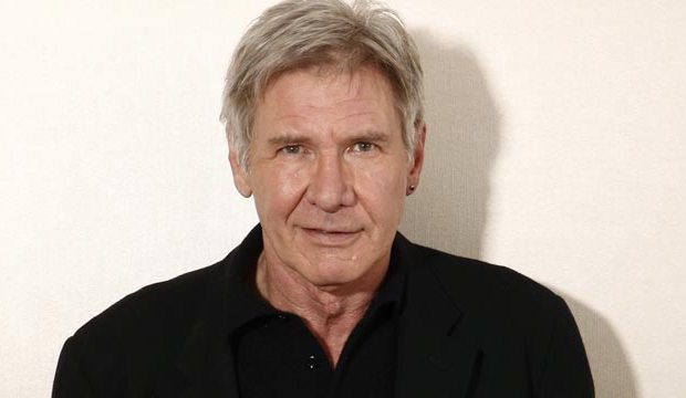 Headshot of actor Harrison Ford smirking at the camera
