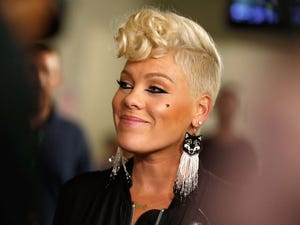 Singer P!nk with blonde hair and shaved sides